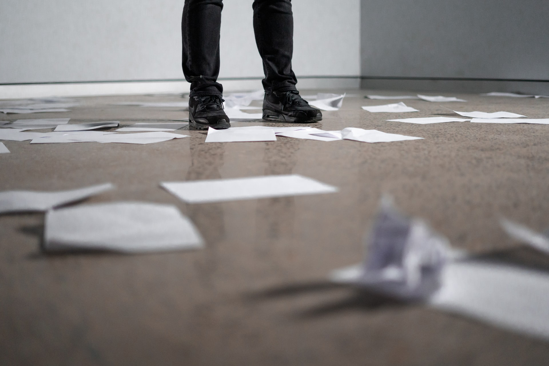 Feet on floor with papers